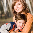 图库照片: Mother and son outdoor set