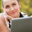 Happy young woman with laptop — Stock Photo #10166234