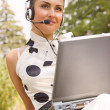 Beautiful woman with laptop and headset — Stock Photo #10166235
