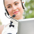 Beautiful woman with laptop and headset — Stock Photo #10166236