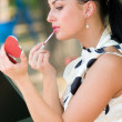 Pretty woman applying cosmetics — Stock Photo #10166244
