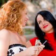 Stock Photo: Two attractive girls, red-haired an brunette with make-up access
