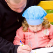 Father teaching little daughter to write — Stock Photo