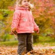 Little blond girl in autumn park — Stock Photo