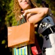 Attractive red-haired woman with shopping bags — Stock Photo #10166318