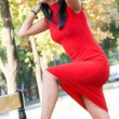 Stock Photo: Gorgeous brunette in red dress