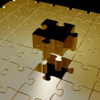 Golden puzzle piece — Stock Photo