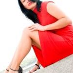 wunderschöne Brünette in rotem Kleid — Stockfoto #10166334