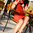 Foto Stock: Pretty woman in street cafe