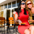 Two attractive women in street cafe — Stock Photo