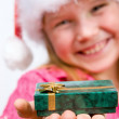 Foto Stock: Girl holding gift box