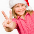 Cute girl with red hat gesturing victory sign — Stock Photo