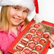 Little girl with candies in box — Stock Photo