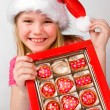 Little girl with candies in box — Stock Photo #10166481