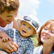 Happy family with son over blue sky background — Stok fotoğraf