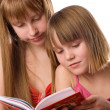 Girls reading open book — Stock Photo
