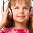 Beautiful happy girl with headphones — Stock Photo