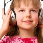 Beautiful happy girl with headphones — Stock Photo