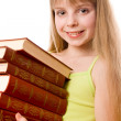 Teenager girl with stack of books — Stock Photo