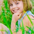 Happy smiling teenager girl on the green meadow — Stock Photo #10166626