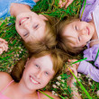 Stock Photo: Pretty children and teenager girls on green grass
