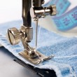 Stock Photo: Close-up of sewing maching with cotton