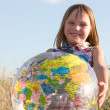 Happy girl with big globe — Stock Photo #10166643