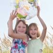 Happy girls holding globe — Stock Photo