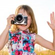 Little girl taking picture with SLR camera — 图库照片