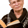 Стоковое фото: Elderly man reading a book
