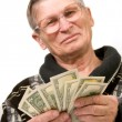 图库照片: Happy old man holding dollars