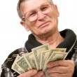 Stock Photo: Happy old mholding dollars