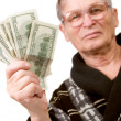 Happy old man holding dollars — Stockfoto