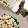 Bride and groom with flowers in front — Foto de stock #10166697