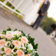 Stock Photo: Bride and groom with flowers in front