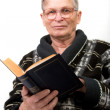 Elderly man reading a book — Stockfoto