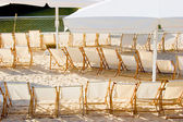 Row of chairs on beach cafe — Foto Stock