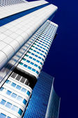Skyscraper vanishing in blue sky — Stock Photo