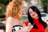 Two attractive girls, red-haired an brunette with make-up access — Стоковое фото