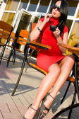 Pretty woman in street cafe — Stock Photo