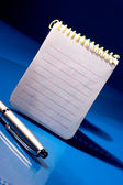 Notepad with pen — Stock Photo