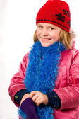 Pretty joyful little girl dressed winter clothes isolated over w — Stok fotoğraf