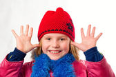 Pretty joyful little girl dressed winter clothes isolated over w — Foto Stock