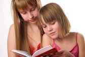 Girls reading open book — Stock Photo