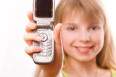 Pretty teenager girl with mobile phone — Stock Photo