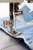 Close-up of sewing maching with cotton — Stock Photo