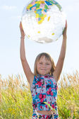 Happy girl with big globe — Stock Photo