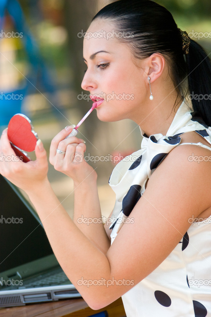 Sensual pretty woman applying cosmetics on her lips  Stock Photo #10166244