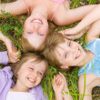 Pretty children and teenager girls on green grass — Foto Stock