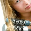 Stock Photo: Blond teen girl with hair brushes